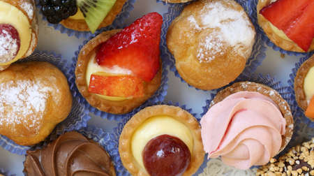 very colorful pastries on a table with blue tablecloth
