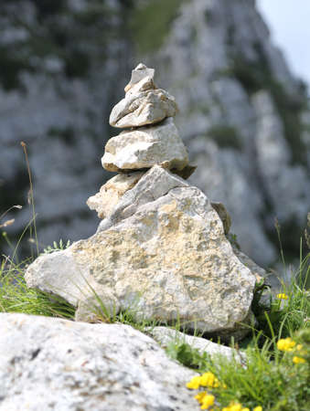 heap of stones called CAIRN in mountain. This stack indicates the right way