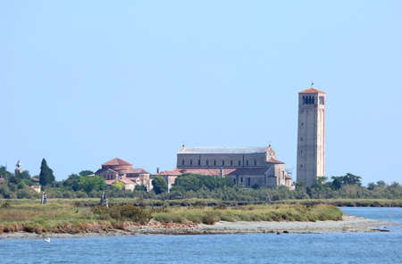 Ancient bell tower and church in the island called TORCELLO near Venice in Italy