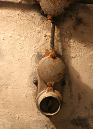 old rusty light switch in a WWII bunker on the border between Italy and Austria Stock Photo
