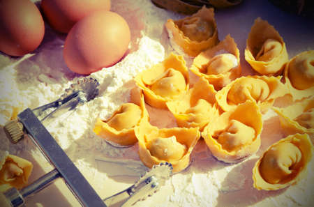 handmade tortellini made with flour and fresh eggs typical of Italian cuisine with vintage effect