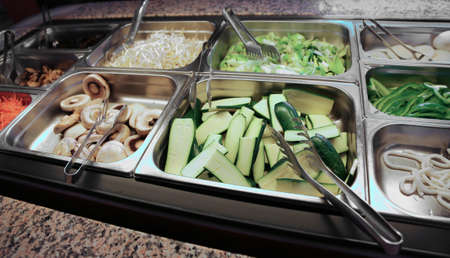 self-service restaurant with lots of fresh vegetables, zucchini and bean sprouts and mushrooms
