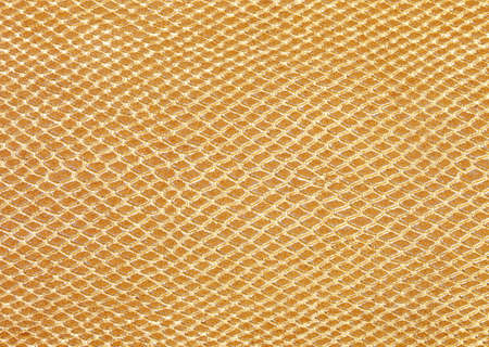 golden background of scales similar to snakeskin with rhomboid shapes Stockfoto