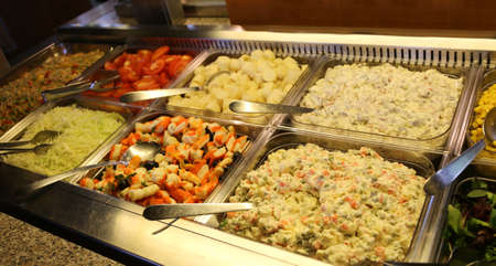 trays full of vegetables, tomato, fish salad and other goodies such as tasty Russian salad with mayonnaise and boiled vegetables