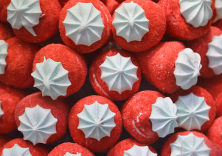 background of red strawberries made with colorful sugar for sale in candy shop