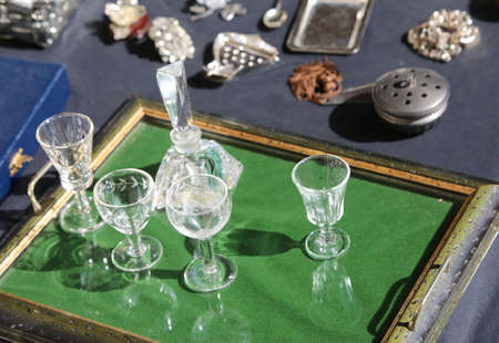 many glasses and more objects in the flea market