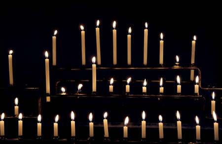 candles with flames in the place of worship