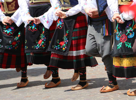 children and little girls dancing with east european clothes Imagens