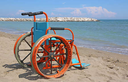 special wheelchair with metal wheels on the beach