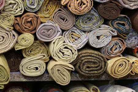 background of fabric rolls of different colors
