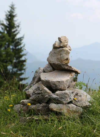 heap of stones called CAIRN or Ometto in italian Language in the European Alps Фото со стока