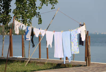 white clothes hanging out to dry outdoors