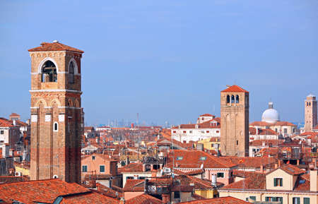 Many bell towers and more roofs in Venice in Italy Stock Photo