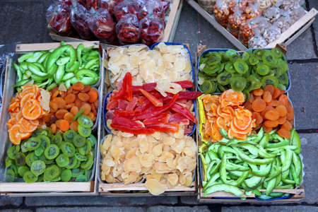 dried fruit boxes for sale in the exotic fruit market with kiwi orange and apricots Stock Photo