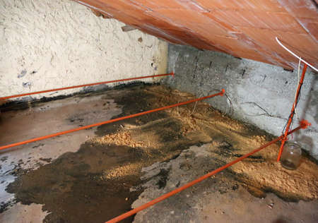 damp attic with serious problems of moisture and seepage from the roof due to the shabby tiles Stok Fotoğraf