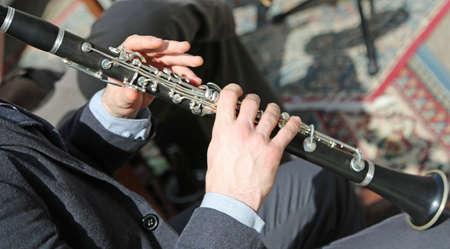 Adult Musician plays the flute in the orchestra Stock Photo