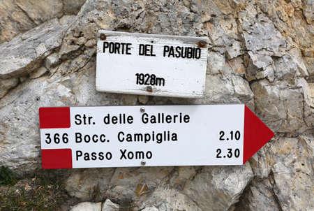 Road sign of the mountain path  in Italian language to go to Pasubio Mountain. Porte del Pasubio means Doors of Pasubio Mount in Italian Language