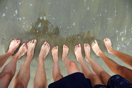 ten feet of a family of five person on the beach
