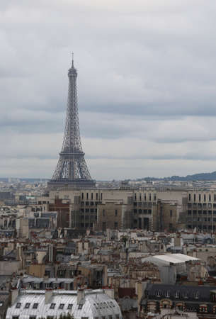 Eiffel Tower from Basilica of Notre Dame in Paris France and many parisan houses