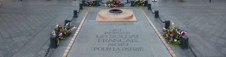 Memorial of Unknown warrior under the Arc de Triomphe in France. The Text means French Soldier died for the fatherland Stock Photo