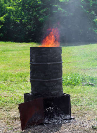 large bin with fire to the production of the embers to make a cheerful picnic outdoors