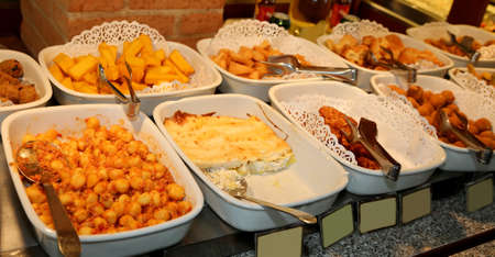 trays full of pasta dishes with gnocchi asparagus pie and other tasty dishes in the restaurant