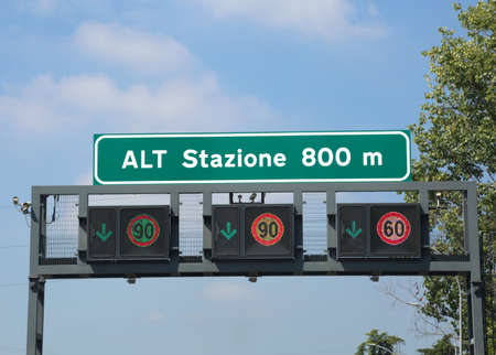 Italian road signs on the highway. The text means STOP Station at 800m and you must pays Stock Photo