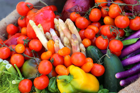 red tomatoes fennel and more fresh vegetables for sale at local market