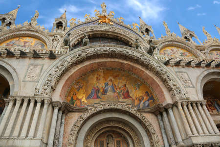 main door of the Basilica of Saint Mark with fantastic mosaics in Venice Italy and blue sky on background Stock Photo