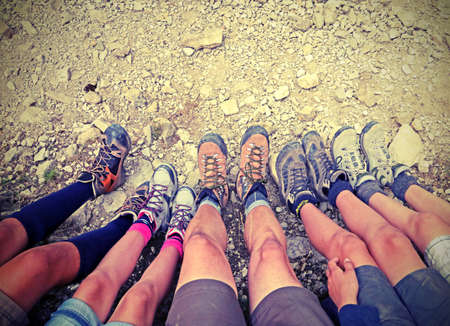 ten trekking shoes of five people with vintage effect Stock Photo