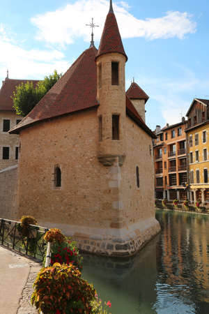 Old building in the Annecy City in France and the small River