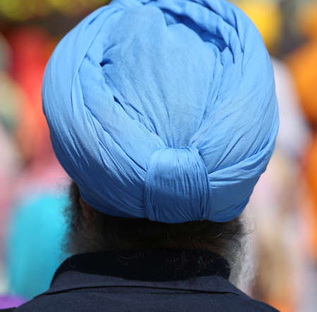 sikh man with blue turban during a religious ceremony Stock Photo