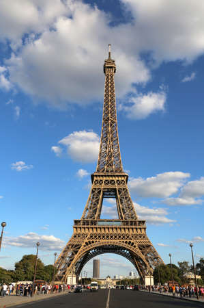 Great Eiffel Tower and the street with few cars in Paris France