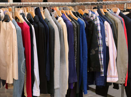many vintage clothes for sale at flea market Stock Photo