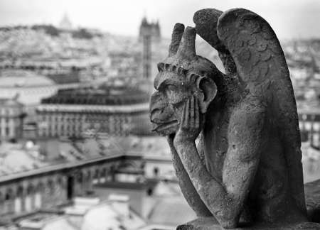 Chimera or grotesque is a fantastic figure used for decorative purposes. This statue is on Basilica of Notre Dame in Paris France with black and white effect