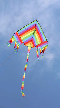 isolated colourful kite on the blue sky