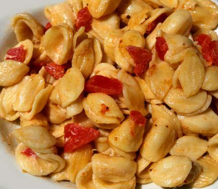 italian pasta called ORECCHIETTE in italian language with tomato sauce Stock Photo