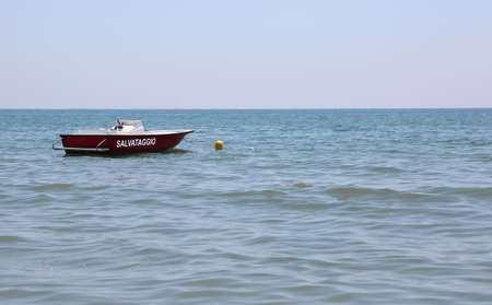 Boat with text SALVATAGGIO that means RESCUE in Italian Stock Photo