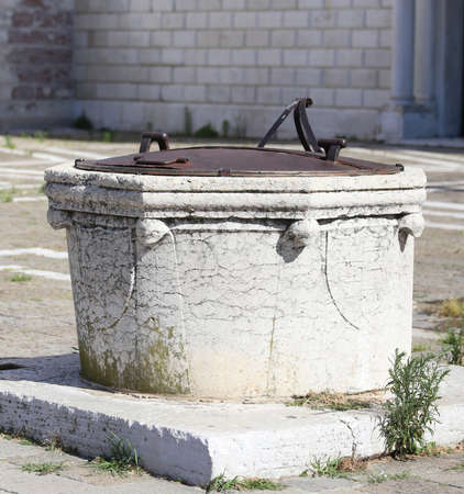 old well to collect rain water on the island of Venice