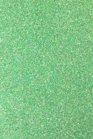 GREEN in glittery material ideal as a bright background Stock Photo