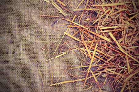 Rural background with jute fabric and straw barn with copy space and vintage effect
