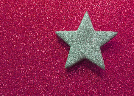 very large silver star in brilliant red background Stock Photo