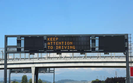 orange highway signs of attention to driving Editorial