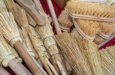 background of many brushes and small brooms in sorghum for sale at market