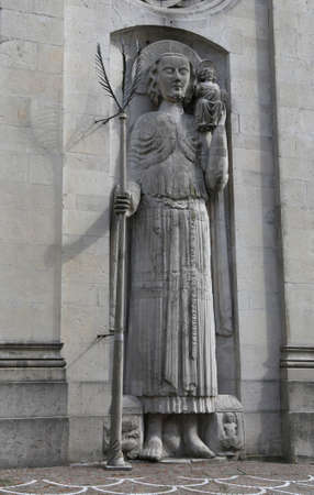 statue of Saint Christopher in front of the Cathedral of Gemona del Friuli in Northern Italy