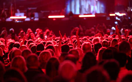 red lights on the heads of people during a live concert Stock Photo - 110763661