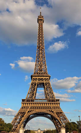 Perfect Eiffel Tower without people and no cars and with blue sky with clouds