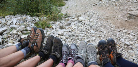 ten lightweight boots of a family of five person in mountains