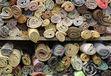 rolls of fabric of different shapes and sizes in a haberdashery