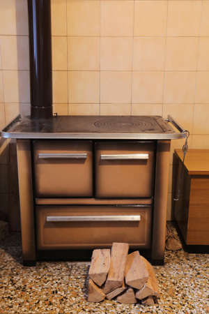 wood-burning stove in the kitchen of the small house Stock Photo
